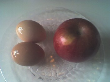 Hard boiled eggs with an apple